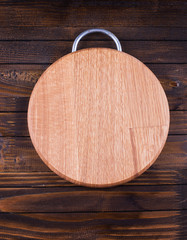 Empty cutting board  on  wooden background.