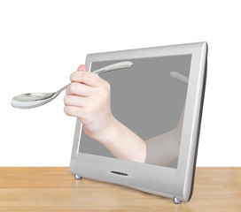 hand with soup spoon leans out TV screen