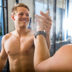 Happy Athlete Giving High-Five To Friend