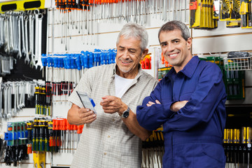Vendor With Customer Holding Packed Tool