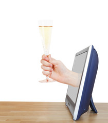 hand raising glass with champagne leans out TV