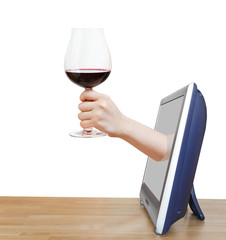 hand raising big glass with red wine leans out TV