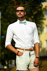 stylish handsome model man in casual cloth outdoors