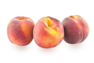 Three peaches on a white background