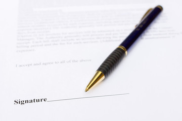 Pen for signature lying on contract paper