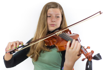 European teenage girl playing violin