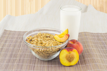 Cereal with milk and peaches on the mat