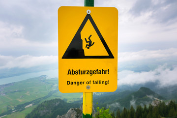Warning sign on the top of mountain in Alps