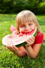 Child eating melon outdoor