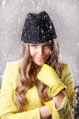 Beautiful young woman in the snow