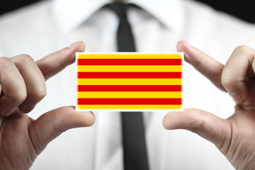 Businessman holding a business card with Catalonia Flag