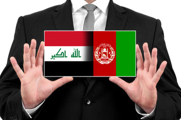 Businessman holding Iraq and Afghanistan Flag