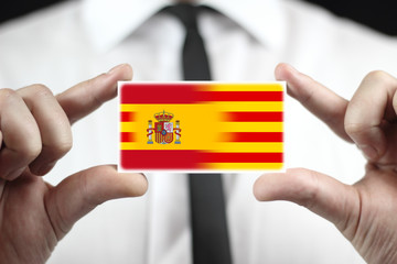 Businessman holding Spain and Catalonia Flag