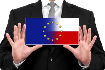 Businessman holding Poland and European Union Flag