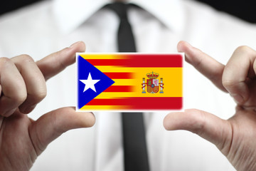 Businessman holding Spain and Independent Catalonia Flag