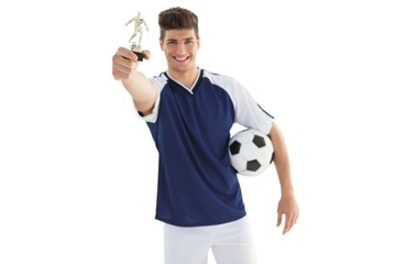 Football player holding winners trophy