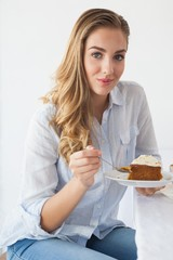 Pretty blonde having cake and coffee