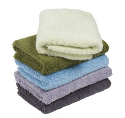 stack of terry towels isolated on white background