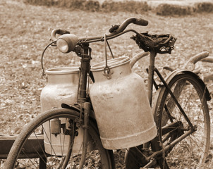 Rusty bike of a milkman of the last century with two bins