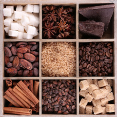 Wooden box with set of coffee and cocoa beans, sugar cubes,