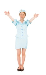 Pretty air hostess with arms raised