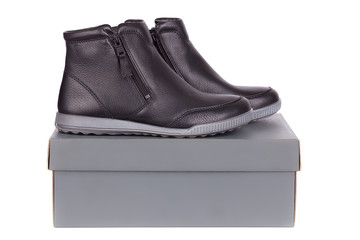A pair of leather female low boots  on top of box
