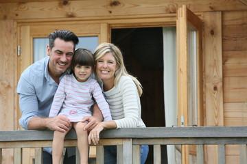 Family enjoying vacation in log cabin