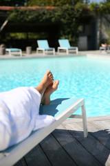 Closeup of woman's feet relaxing in long chair