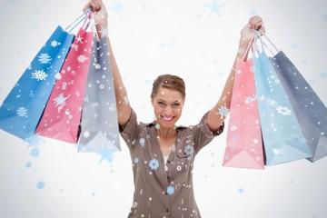 Smiling woman raising her shopping bags