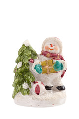 Snowman with Christmas tree and gifts isolated on white backgrou