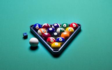 Billiard balls arranged in a triangle