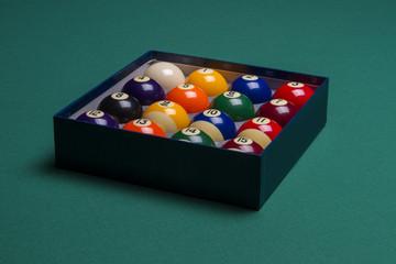 Billiard balls set in a  box