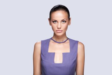 closeup on elegant woman in fashionable stylish dress posing