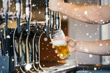 Composite image of barmans arms pulling a pint of beer