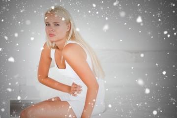 Composite image of sick woman having a stomach ache