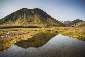 Green volcanic mountain in southern Iceland