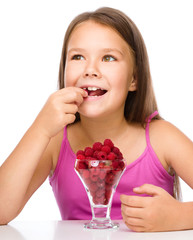 Little girl with raspberries