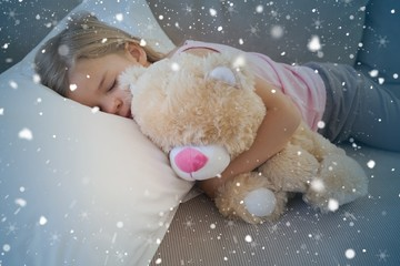 Girl sleeping on sofa with stuffed toy