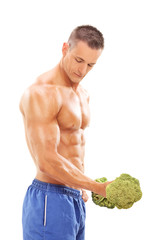 Male bodybuilder exercising with a broccoli dumbbell