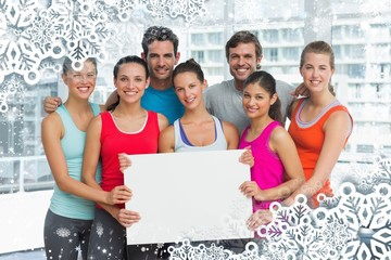 Fit smiling people holding blank board