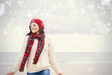 Pretty woman in stylish warm clothing at beach