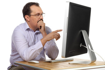 Thoughtful man with mustache pointing at computer monitor