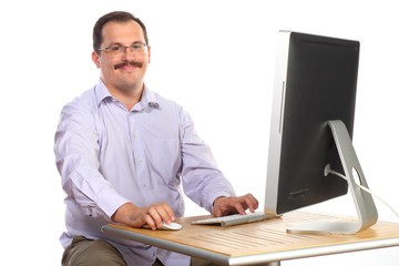 businessman sitting at desk in front of computer