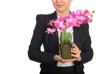 Woman in suit holding flowerpot with artificial flower orchid