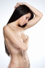 Portrait of hot brunette covering her breasts