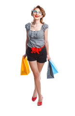 Woman walking with ashopping bags