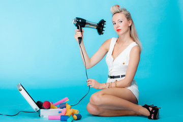 sexy girl retro style in curlers with hairdryer styling hair