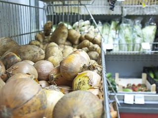 onion, potato on market shelve