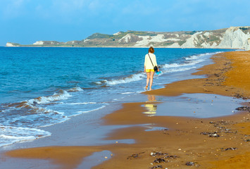 Woman and Xi Beach morning view (Greece, Kefalonia).