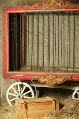 Empty cage for animals with gold ornament in circus